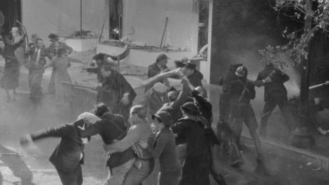 ms shot of people rioting in street - ribellione video stock e b–roll