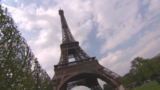 ws shot of people roaming and enjoying at eiffel tower / paris, france - eiffel tower paris stock videos & royalty-free footage