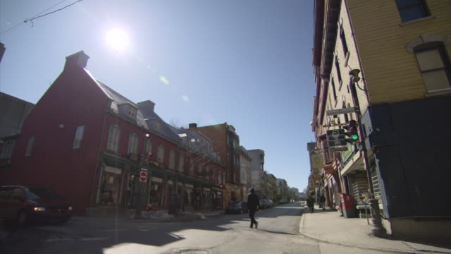 ws shot of people roaming at town area / quebec, canada - town stock videos & royalty-free footage