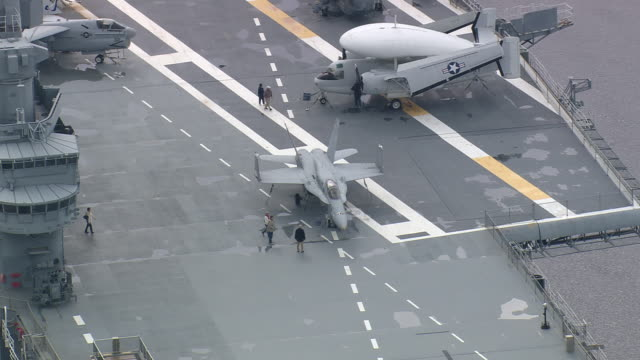 MS AERIAL Shot of people roaming at USS Yorktown Museum / South Carolina, United States