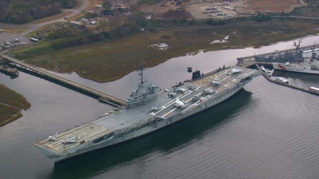 MS AERIAL ZI Shot of people roaming at USS Yorktown Museum / South Carolina, United States