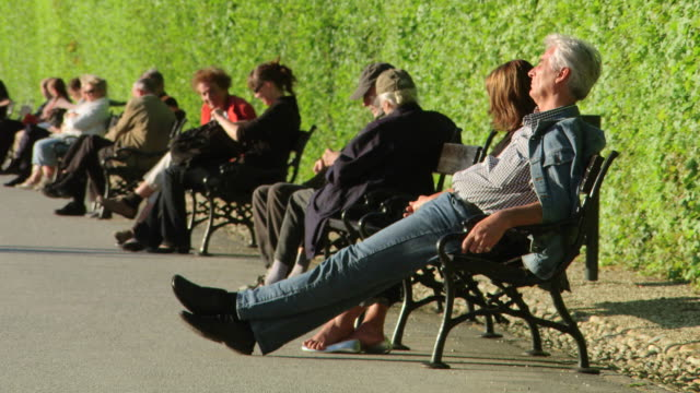 MS Shot of People sat on benches at Belvedere Palace / Vienna, Austria