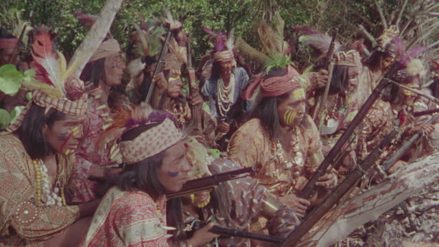 ms ts shot of people seating then standing in forest - north american tribal culture stock videos and b-roll footage