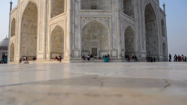 ms shot of people sitting and roaming at taj mahal, / agra, utter pradesh, india - taj mahal stock videos and b-roll footage
