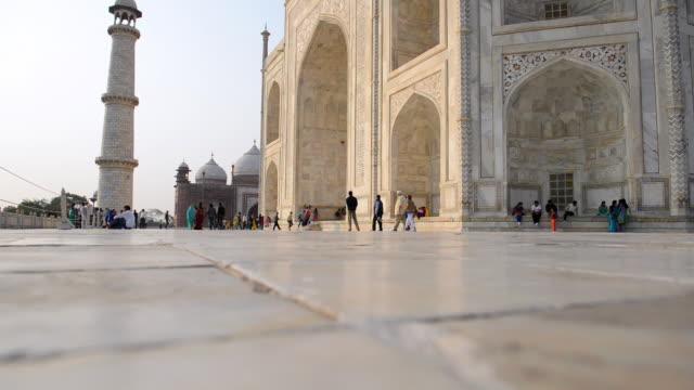 MS Shot of people sitting and roaming at Taj Mahal, / Agra, Utter Pradesh, India