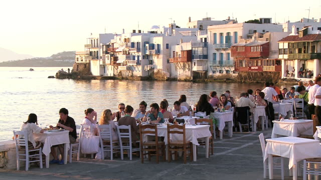 MS Shot of people sitting at Little Venice restaurant / Mykonos, Cyclades, Greece