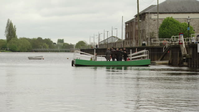 ws shot of people taking ferry to cross river / exeter, united kingdom - exeter england stock videos & royalty-free footage