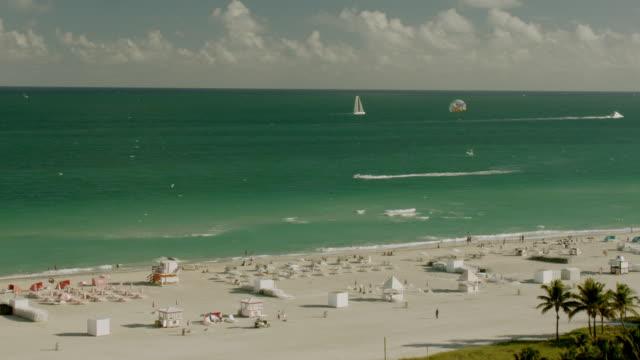 ms pan shot of people taking on south beach / miami, florida, united states - miami beach stock videos & royalty-free footage