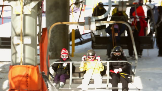 ms shot of people taking ski lift / pyeongchang, gangwon-do, south korea - ski jacket stock videos & royalty-free footage