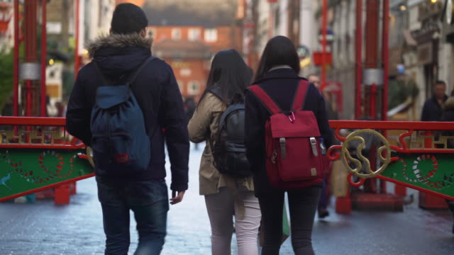 shot of people walking along gerrard street in london's chinatown district. - chinatown stock videos and b-roll footage