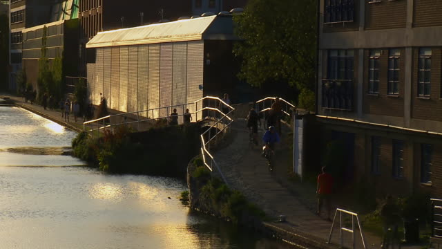 ms t/l shot of people walking alongside canal in london / london, united kingdom  - canal stock videos & royalty-free footage