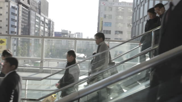 MS POV shot of People walking at escalato/ Tokyo, Greater Tokyo, Japan