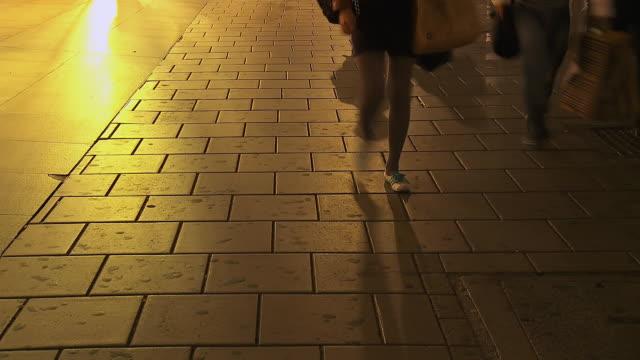 MS T/L LA Shot of People walking down Oxford Street at sunset / London, United Kingdom