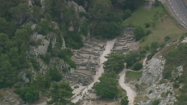 WS AERIAL Shot of people walking in ancient area, St Remy De Provence / Provence Alpes Cote D'Azur, France