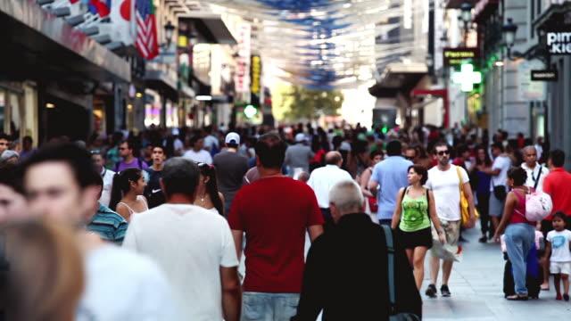 ws shot of people walking in madrid street / madrid, spain - madrid stock videos and b-roll footage