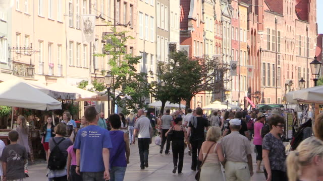 ms shot of people walking in market square dlugi targ at old town gdansk, poland / gdansk, baltic coast, poland - poland stock videos & royalty-free footage