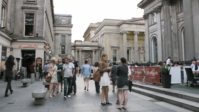 MS Shot of People walking in street at royal exchange square / Glasgow, Scotland, United States