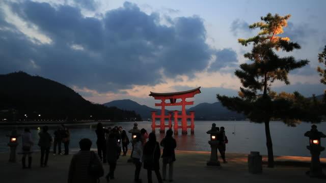MS Shot of People walking near Itsukushima Shrine,UNESCO World Heritage / Hatsukaichi, Hiroshima Prefecture, Japan