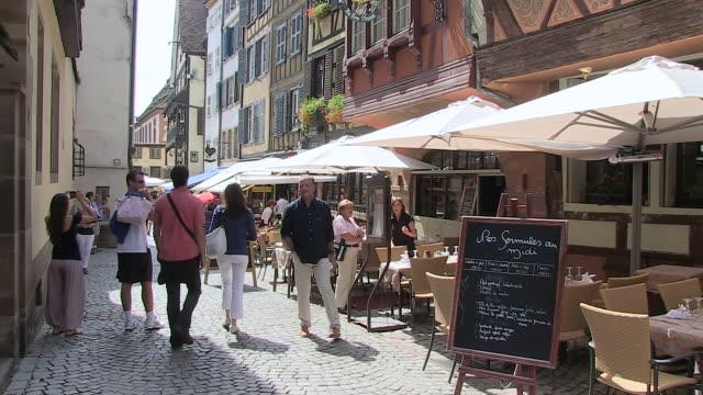 MS  Shot of people walking on street at Old town Petite France, Rue du Maroquin / Strasbourg, Alsace, France