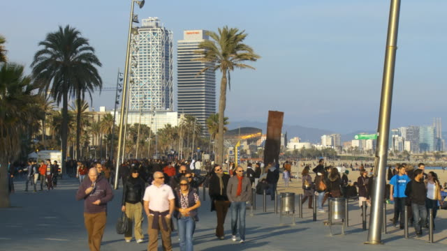 WS Shot of people walking on street near Barceloneta beach / Barcelona, Catalonia, Spain