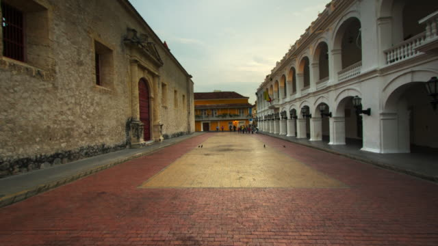 MS T/L POV Shot of people walking through plaza / Cartagena, Colombia