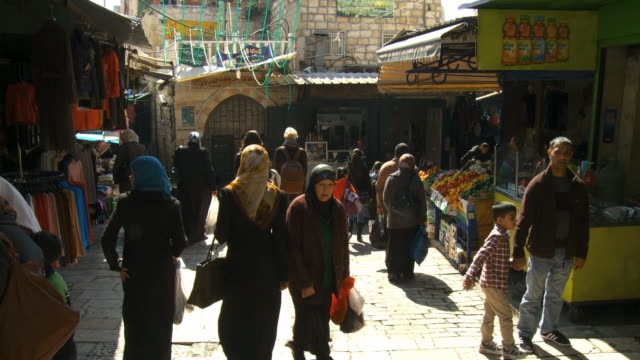 MS Shot of People walking up and down steps at Muslim quarter / Jerusalem, Judea, Israel