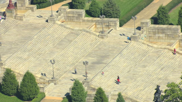 ms aerial ts shot of people walking up staircase to philadelphia museum of art / philadelphia, pennsylvania, united states - staircase video stock e b–roll