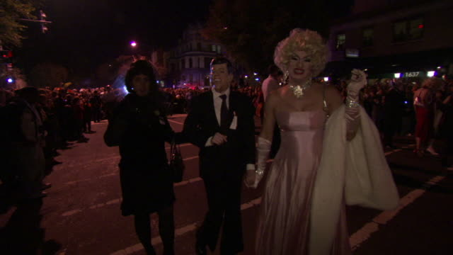 ws ts shot of people wearing john kennedy and marilyn monroe costumes poses and waving during high heel race in dupont circle / washington, dist. of columbia, united states - dupont circle stock videos & royalty-free footage