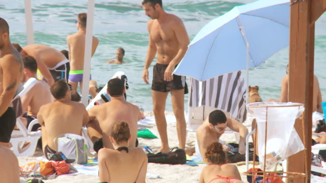 MS Shot of people with bathing suits having fun on sunny day / Tel Aviv, Dan Metropolitan,Gush Dan, Israel
