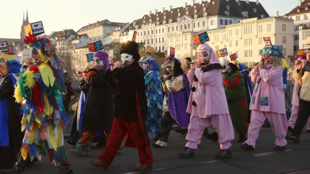 ws pan shot of people with mask and dressing up celebrating basler fasnacht (basel carnival) on street / basel, switzerland - animal imitation stock videos and b-roll footage