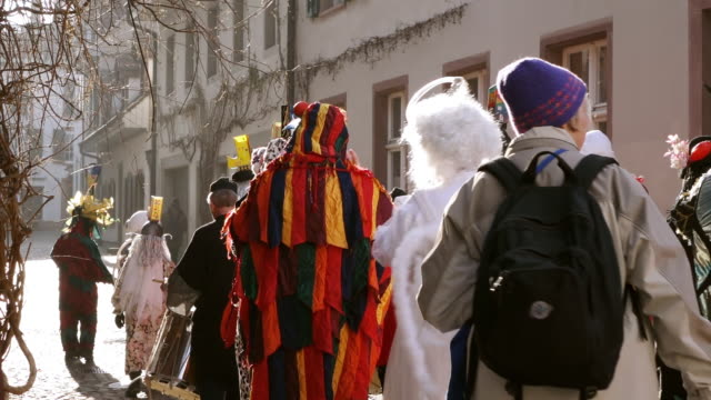 ms shot of people with mask and dressing up celebrating basler fasnacht (basel carnival) on street / basel, switzerland - animal imitation stock videos and b-roll footage