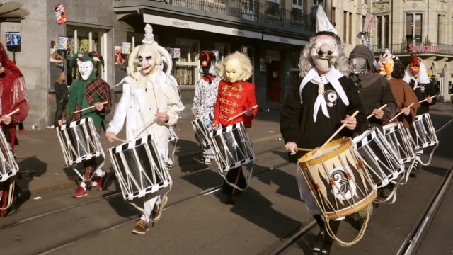 ms shot of people with mask and dressing up playing drums at celebrating basler fasnacht (basel carnival) on street / basel, switzerland - animal imitation stock videos and b-roll footage