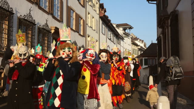 ws shot of people with mask and dressing up playing flute celebrating basler fasnacht (basel carnival) on street / basel, switzerland - animal imitation stock videos and b-roll footage