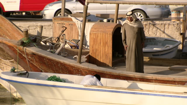 shot of people working on the boat / doha qatar - doha stock videos & royalty-free footage