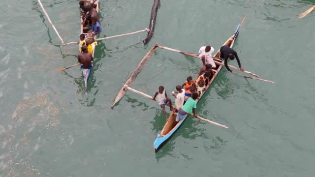 ms ha shot of peoples seating in fisher ship / tolagnaro, madagascar - madagaskar stock-videos und b-roll-filmmaterial