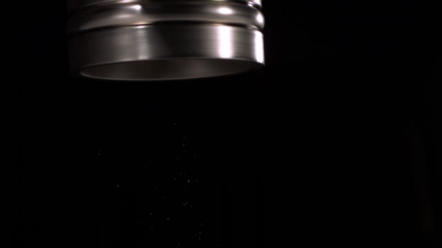 cu slo mo shot of pepper coming out of shaker / studio, new jersey, united states - pepper seasoning stock videos and b-roll footage