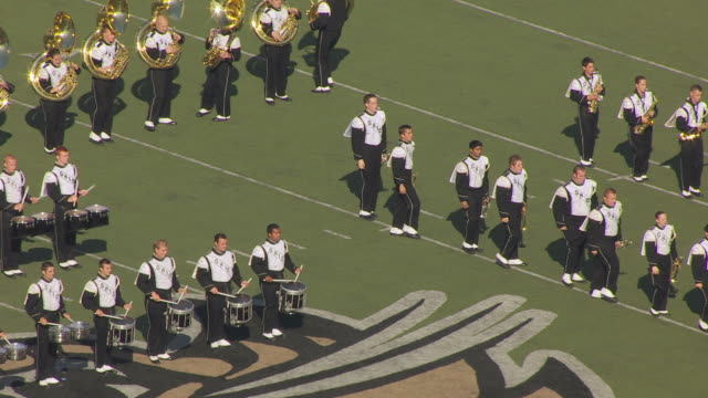 ms td aerial shot of percussion players and brass players during marching band practice for ohio university homecoming parade / athens, ohio, united states - 音楽隊点の映像素材/bロール