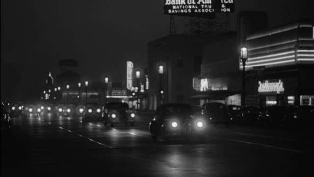ms ts shot of period cars driving on streets of hollywood - western script stock videos & royalty-free footage