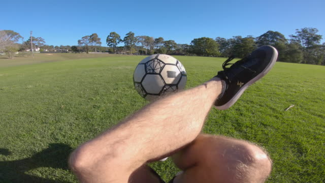 pov shot of person doing advanced freestyle soccer tricks sitting down - juggling stock videos & royalty-free footage