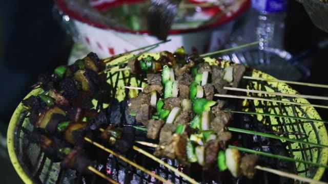 MS Shot of person flavoring vegetable kebab / Kohima, Nagaland, India
