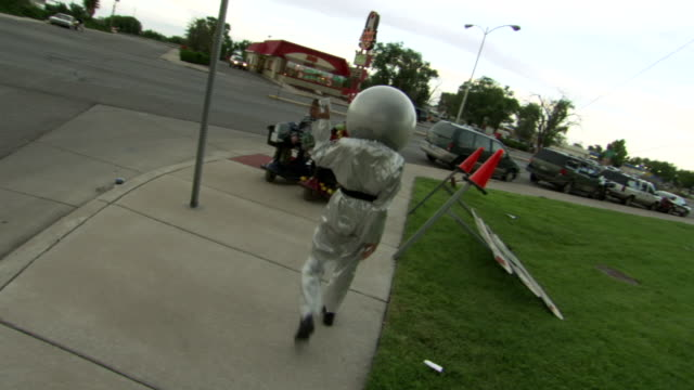 ms zo tu td shot of person in silver alien costume dances on street during roswell ufo festival costume contest / roswell, new mexico, united states - contestant stock videos & royalty-free footage