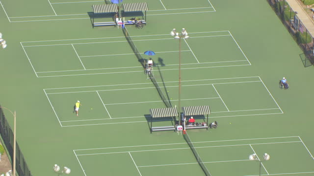 ms aerial shot of person in wheel chair playing tennis on court during us open usta wheelchair championships / st louis, missouri, united states - tennis stock videos & royalty-free footage