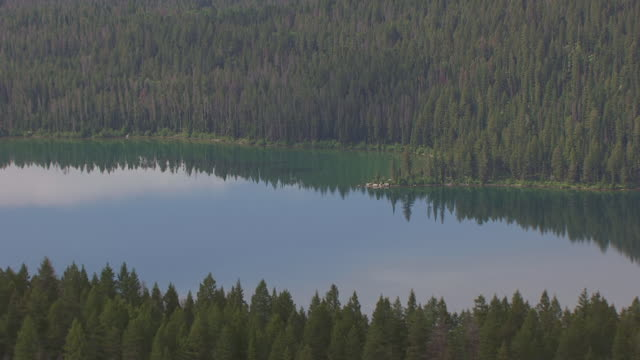 ms aerial shot of phelps lake with sky and clouds reflected and valley in grand teton national park / wyoming, united states - grand teton national park stock videos & royalty-free footage