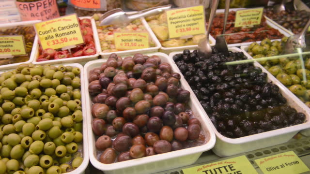 ms pan shot of pickled olives in delicatessen shop in ambrogio market / florence, tuscany, italy - western script stock videos & royalty-free footage