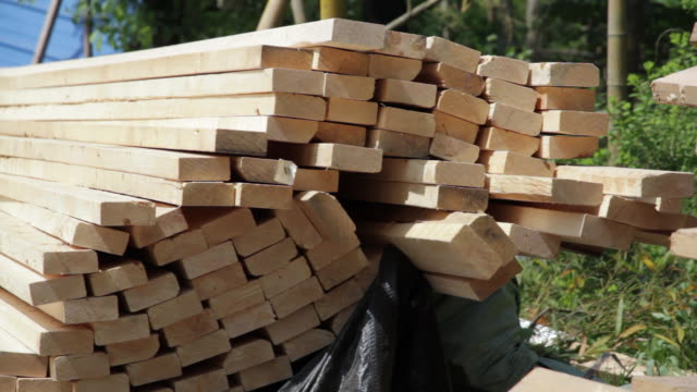 cu shot of pile of wood / nanjing, jiangsu, china - nanjing stock videos & royalty-free footage