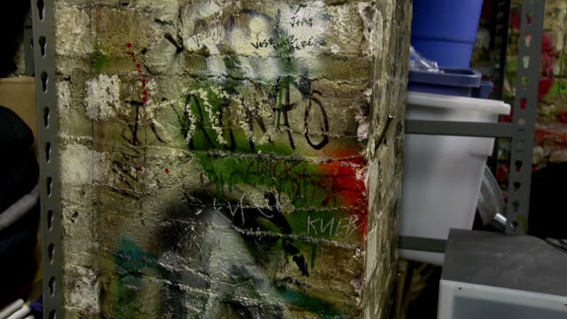 MS TD Shot of Pillar covered with graffiti preserved from CBGB club days at John Varvatos store in the Bowery neighborhood of Manhattan / New York, United States