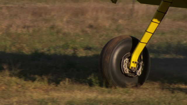 CU ZO TS Shot of Plane wheel and takes off / Melbourne, Australia