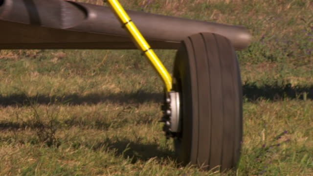 cu ts shot of plane wheel on runway / melbourne, australia - wheel stock videos & royalty-free footage