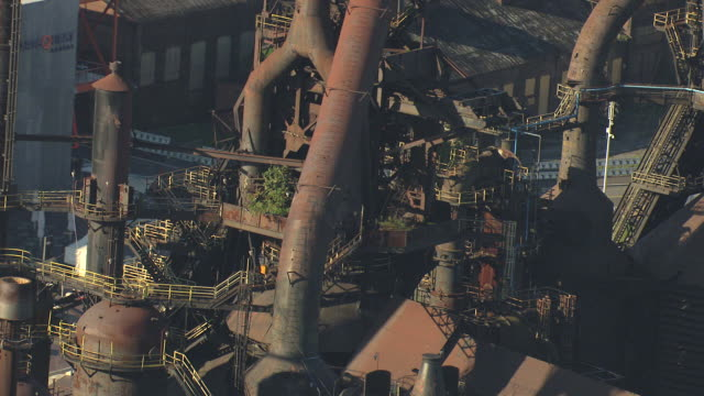 cu aerial zo shot of plant growing in pipes at bethlehem steel plant / bethlehem, pennsylvania, united states - ペンシルベニア州点の映像素材/bロール