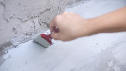 shot of plastered base ground in the house - grey colour stock videos & royalty-free footage